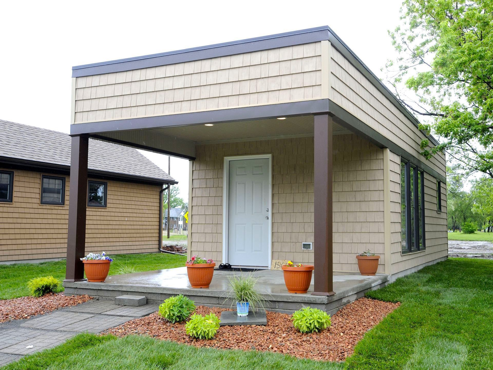 Tiny homes help low income workers become homeowners in for Low income home builders